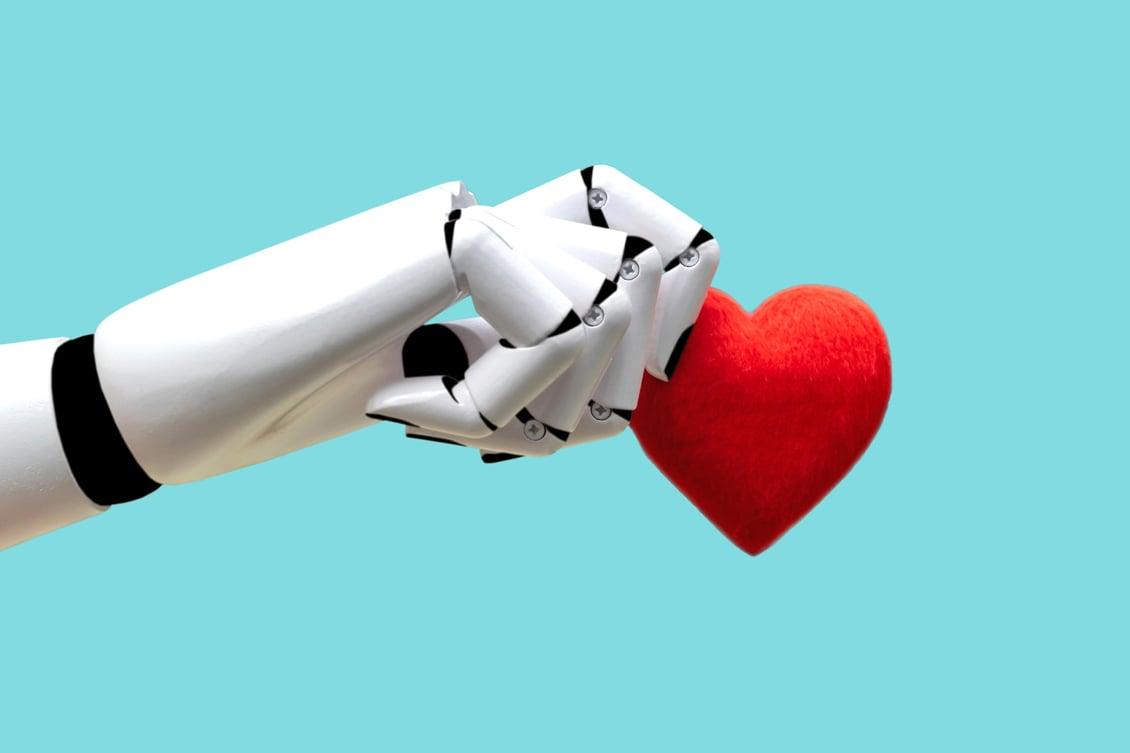 Imagem de um robô segurando um coração, representando a humanização do RH com a inteligência artificial